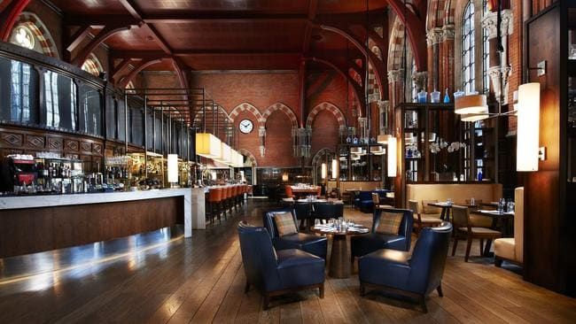 At London St Pancras passengers can wait for their train at a bar in the old booking office. Picture: stpancraslondon.com