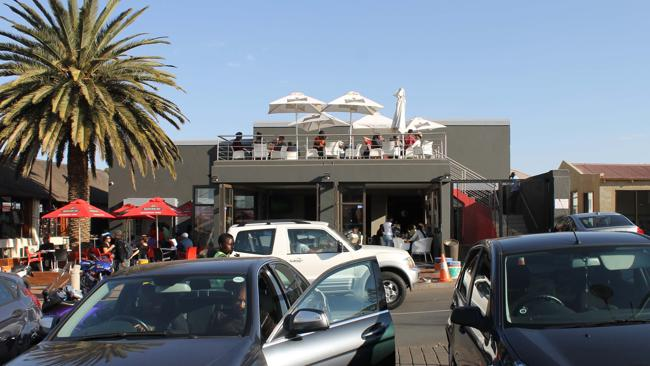 Soweto's Vilakazi Street has been transformed into a hip, cashed-up area, with new restaurants and bars opening.