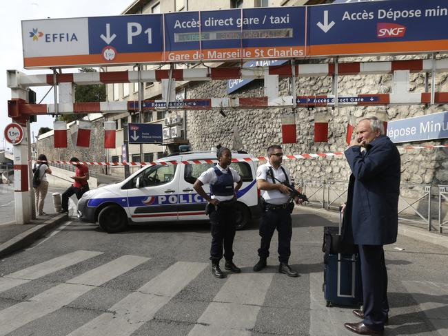 French police officers patrol outside the Marseille railway station. Picture: AP Photo/Claude Paris