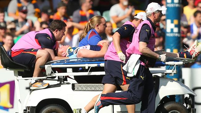 Lynch was stretchered off the ground against Brisbane.