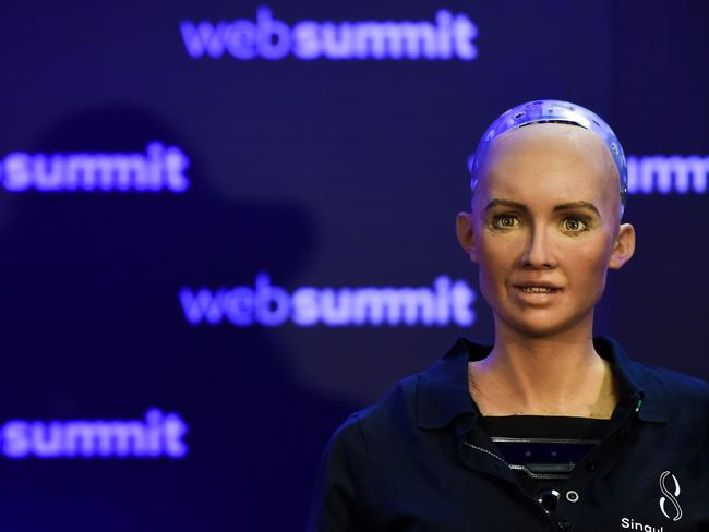 """Humanoid """"Sophia The Robot"""" of Hanson Robotics answers questions during a press conference at the 2017 Web Summit in Lisbon. Picture: Patricia de Melo Moreira"""