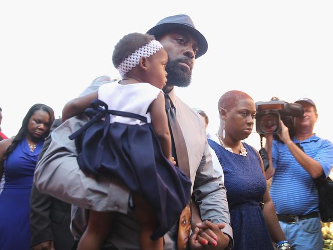 A father's loss ... Michael Brown Sr. arrives for the funeral of his son Michael Brown Jr. Source: AFP