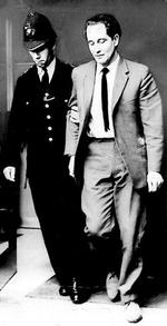 Ronnie Biggs is escorted by police into a court hearing in London in 1965.