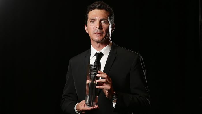Guillermo Amor poses with the A-League Coach of the Year Award.