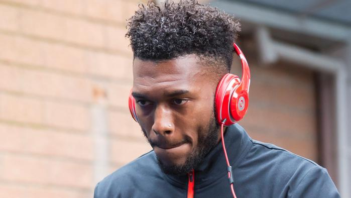 Liverpool's English striker Daniel Sturridge arrives at the ground ahead of the English Premier League football match between Burnley and Liverpool at Turf Moor in Burnley, north west England on August 20, 2016. / AFP PHOTO / JON SUPER / RESTRICTED TO EDITORIAL USE. No use with unauthorized audio, video, data, fixture lists, club/league logos or 'live' services. Online in-match use limited to 75 images, no video emulation. No use in betting, games or single club/league/player publications. /