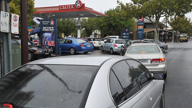 Traffic banks up at Caltex O'Connell St, North Adelaide, which was selling petrol for 88.8c per litre as part of Clipsal 500 promotion. Picture: Campbell Brodie