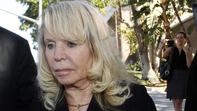 Shelly Sterling, the estranged wife of Clippers owner Donald Sterling, leaves a Los Angeles courthouse.