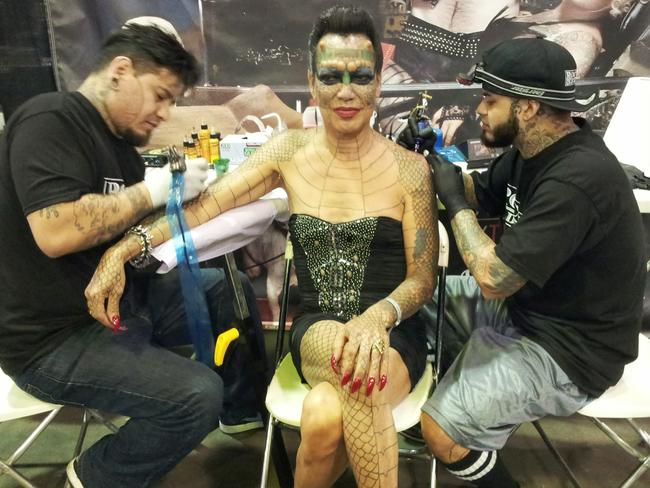 Tiamat with tattoo Artists, Rick Moreno (R) and Drew De la Fuente (L) at New York Tattoo Convention in June 2013. Picture: Media Drum World/Australscope