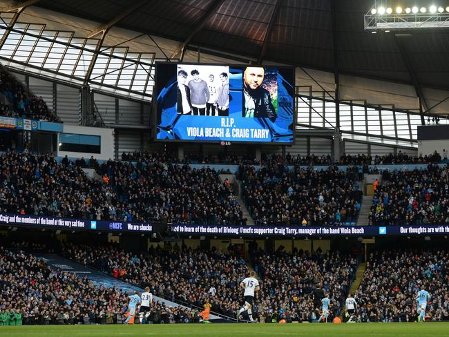 Photographs of the members of the band Viola Beach and their manager Craig Tarry was displayed on a screen ahead of the English Premier League football match between Manchester City and Tottenham Hotspur. Picture: AFP/OLI SCARFF