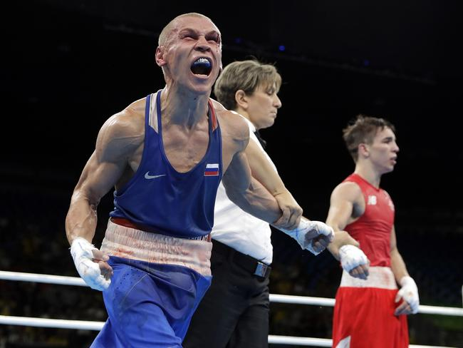 Russia's Vladimir Nikitin, left, reacts as he won a men's bantamweight 56-kg quarterfinals boxing match against Ireland's Michael John Conlan