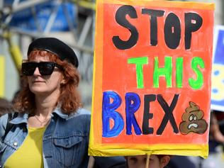 Demonstrators hold placards as they prepare to participate in an anti Brexit, pro-European Union (EU) march in London on March 25, 2017, ahead of the British government's planned triggering of Article 50 next week. Britain will launch the process of leaving the European Union on March 29, setting a historic and uncharted course to become the first country to withdraw from the bloc by March 2019. / AFP PHOTO / CHRIS J RATCLIFFE