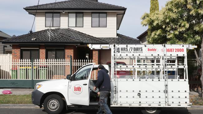 A glass repairman arrives to fix damage to the rental property. Picture: David Crosling