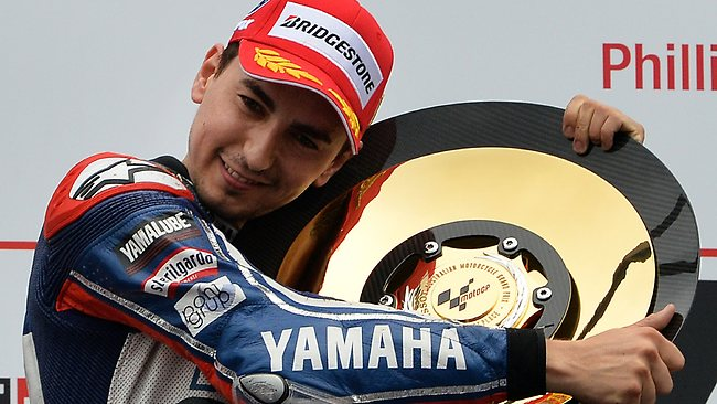 Yamaha's Jorge Lorenzo of Spain poses with his award on the podium after winning the Australian MotoGP Grand Prix at Phillip Island