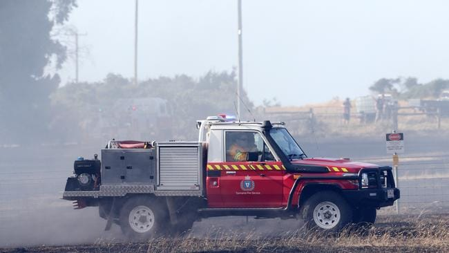 Tasmania Fire Service crews mop up a vegetation fire at George Town. Picture: CHRIS KIDD