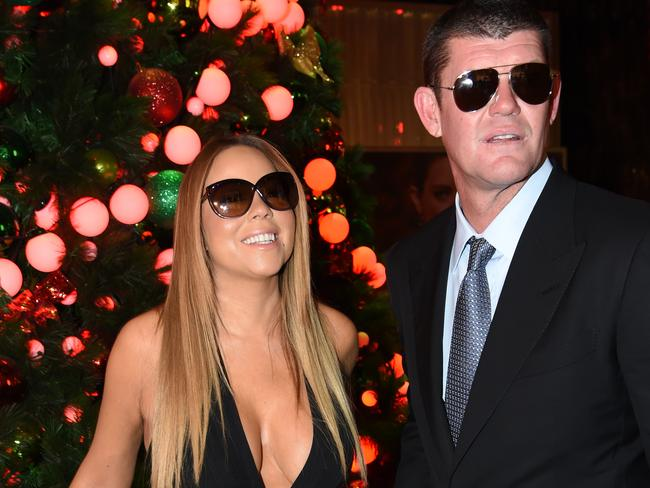 Mariah Carey is greeted by James Packer at the Crown Atrium. Picture: Tony Gough
