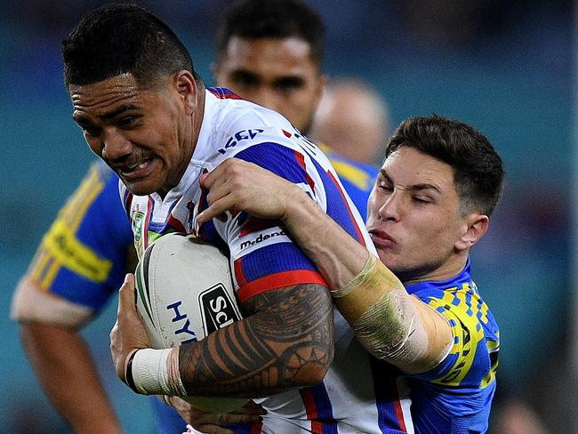 Peter Matautia of the Knights is tackled by Mitchell Moses during an upset win.