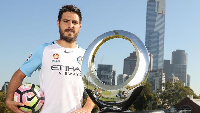 Melbourne City captain Bruno Fornaroli with the A-League trophy.