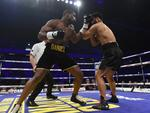 Daniel Dubois (L) in boxing action with AJ Carter during the vacant BBBofC Southern Area Heavyweight Title fight at Copper Box Arena on September 16, 2017 in London, England. Picture: Leigh Dawney/Getty Images