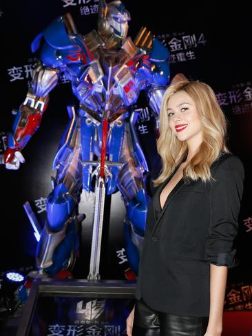 The actress hits the red carpet for the movie's Beijing premiere.