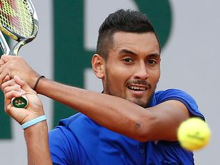Australia's Nick Kyrgios returns the ball to Italy's Marco Cecchinato during their first round match at the Roland Garros 2016 French Tennis Open in Paris on May 22, 2016. / AFP PHOTO / THOMAS SAMSON