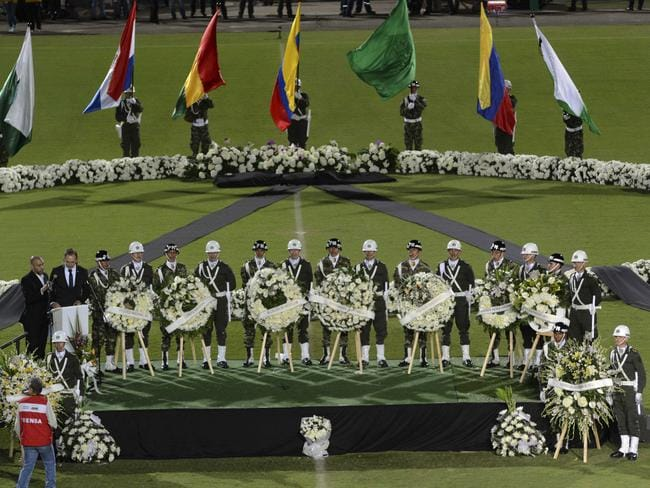 Soldiers and police attend a tribute to members of Brazil's Chapecoense.