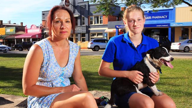Sioux Hardiman with her daughter Sam, 16, and dog Timmy in Mansfield yesterday. Ms Hardiman says she is more cautious when she visits Melbourne. Picture: Aaron Francis