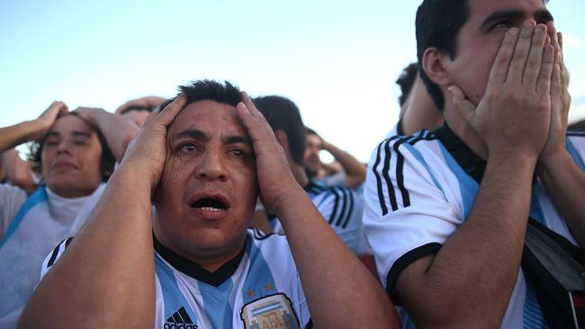 :The horror. Argentina fans react. (Photo by Mario Tama/Getty Images)