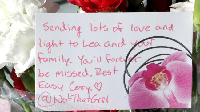 Fans leave flowers and letters for the late Cory Monteith outside The Fairmont Pacific Rim hotel in Vancouver, where he was found dead on Saturday. Picture: Splash News