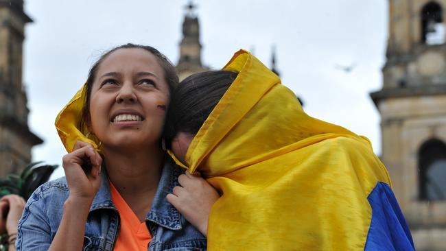 Colombian fans react in Bogota, Colombia.