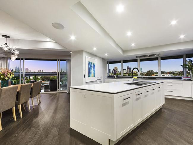 Luke and Ebony's vast kitchen also has city views. Picture: realestate.com.au