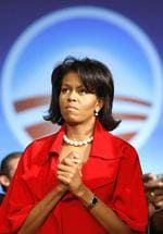 <p>Michelle Obama, wife of US Democratic presidential candidate Senator Barack Obama (D-IL), watches him as he makes his remarks at his 'Super Tuesday' primary election night rally in Chicago, Illinois, February 5, 2008.</p>