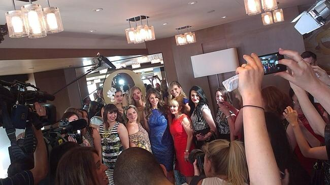 Liz Hurley fronting the media scrum with designs from the new Queenspark collection.