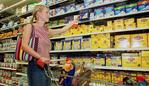 13 Feb 2002 Coles/Myer shopper in aisle at New Farm grocery store. PicDerek/Moore retail stores groceries trolley shops shopping packets of tea