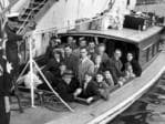 Passengers from the ocean liner Strathaird leave the ship for the Torrens Island quarantine station near Port Adelaide, in 1954.