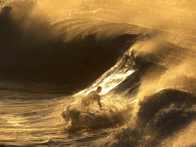 Epic waves in a golden sunrise. Picture: John Grainger