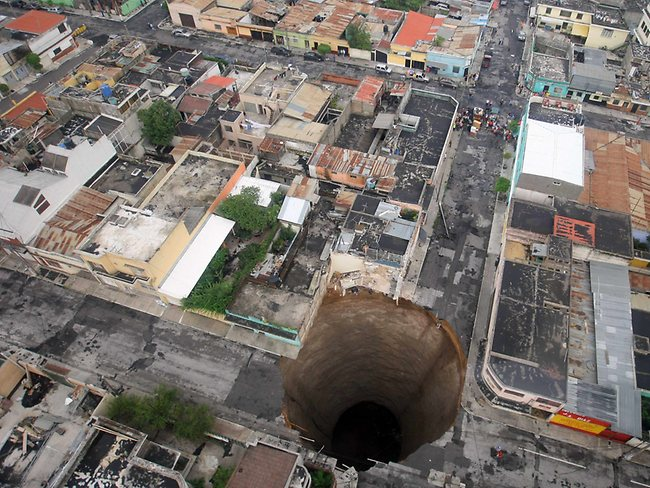 This gigantic sinkhole covered a street intersection in downtown Guatemala City in 2010. A day earlier authorities blamed the heavy rains caused by tropical storm Agatha as the cause of the crater that swallowed a a three-story building. At least three people died. AP Photo/Guatemala's Presidency, Luis Echeverria