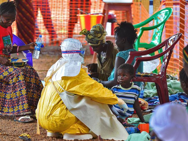 No cure ... a medical worker feeds an Ebola child victim at an MSF facility in Kailahun. Picture: Carl de Souza
