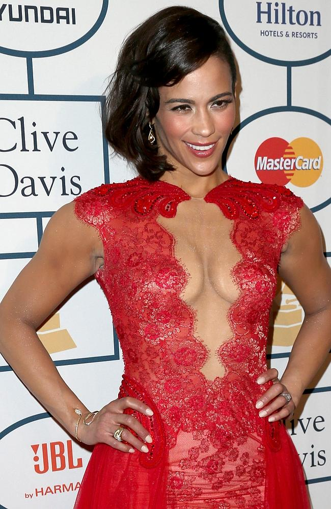 Actress Paula Patton attends the 56th annual GRAMMY Awards Pre-GRAMMY Gala and Salute in a daring red dress.