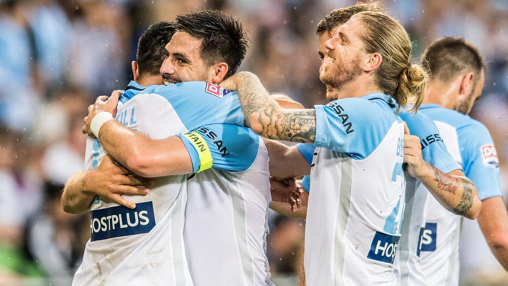 A-League round 12; Melbourne City FC v Perth Glory at AAMI Park, Melbourne. Melbourne City's Tim Cahill and Luke Brattan congratulate Bruno Fornaroli on his first-half goal. Photo: Stuart Walmsley