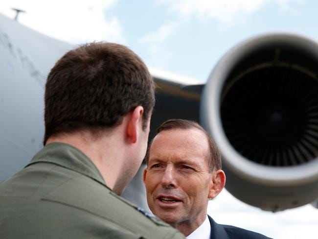 Lavish praise yet job not complete ... Prime Minister Tony Abbott talks with a crew member of the Royal Australian Air Force C-17 aircraft during a visit to Eindhoven's air base. Picture: AFP