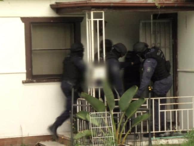 Strike back.... Strike Force Raptor officers raid a home in Sydney. Photo: NSW Police