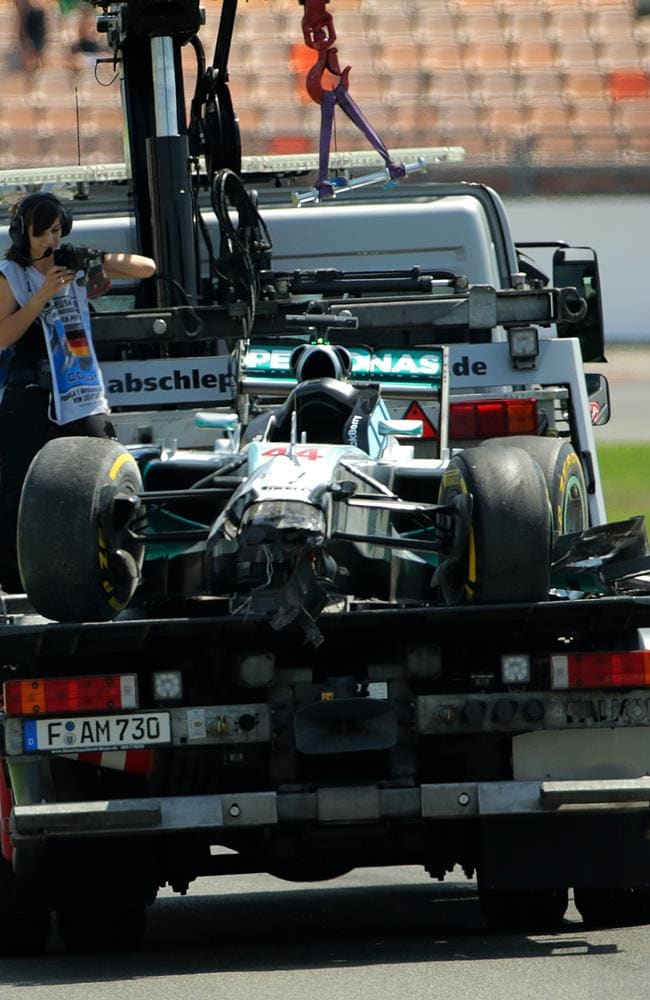 Lewis Hamilton's car is taken back to the team garage after his crash in qualifying.