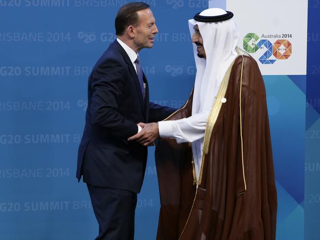 Friendly relations ... Australian Prime Minister Tony Abbott officially welcomes Saudi Arabian King Abdullah bin Abdulaziz al-Saud to the Brisbane G20, at the Brisbane Convention and Entertainment Centre. Picture: Anthony Weate