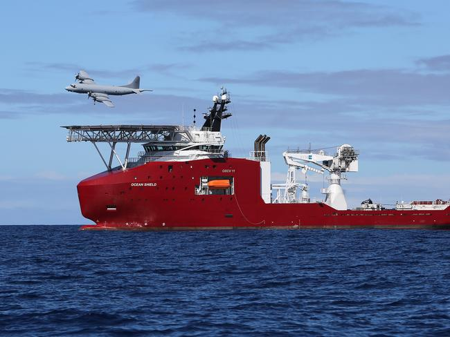 A Royal Australian Air Force AP-3C Orion flies past Australian Defence Vessel Ocean Shield during the search for MH370.