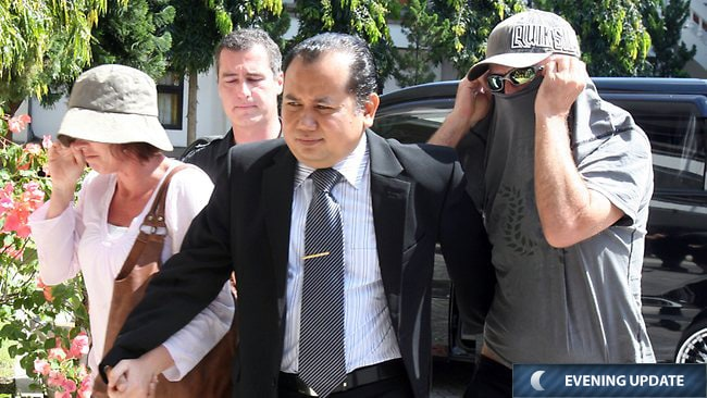 Mohammad Rifan, lawyer of the Australian teen in Bali on drug charges, and the boy's parents as they arrived at the prosecutor's office. Picture: Bintoro S Lukman