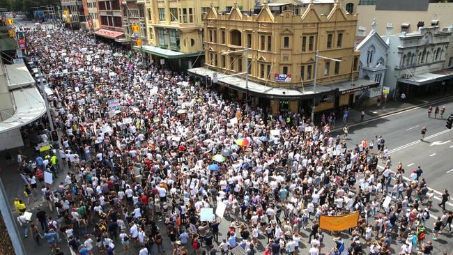 Crowds march through Elizabeth St. Picture: Stephen Cooper