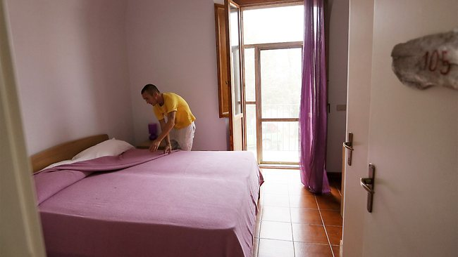 The prisoners take care of the new tourist facilities, from room service at the hotel to cooking. Picture: AFP