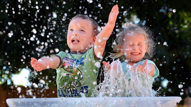 Dean Gruar, 4, and Claire Perry, 4, make a splash. Picture: David Caird