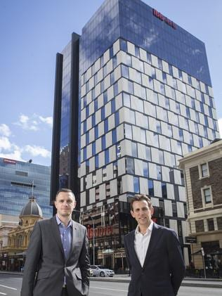 Ibis Adelaide general manager Nathan Frost and Hines Group's James Hines at the front of the new Ibis Hotel in Grenfell Street ... the venue opened last month.