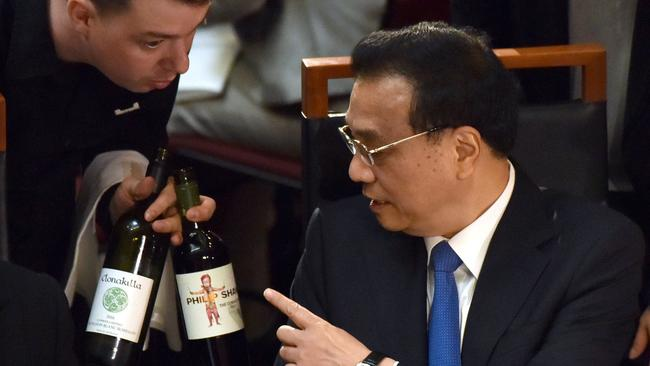 Mr Li discusses the merits of Australian reds at the official luncheon.